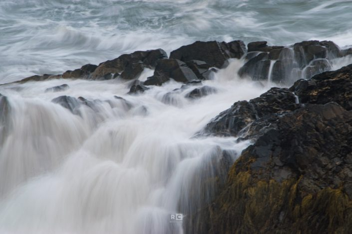 Waters crashing over the rocks